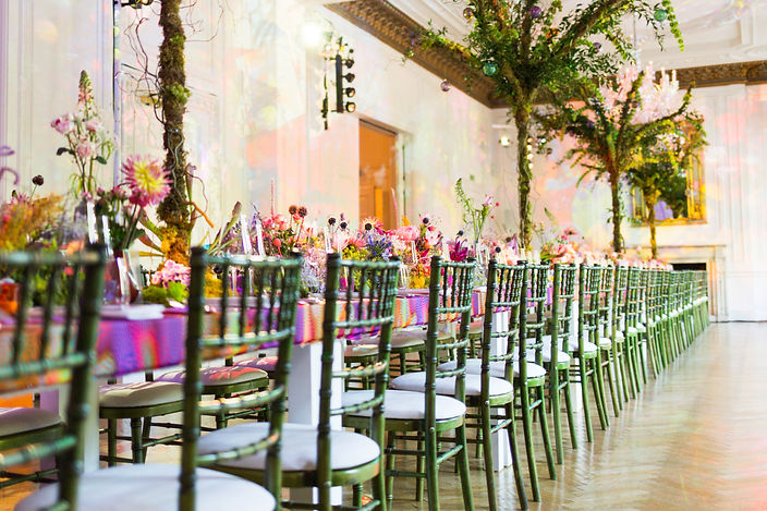 Long table with colourful pink and blue flowers