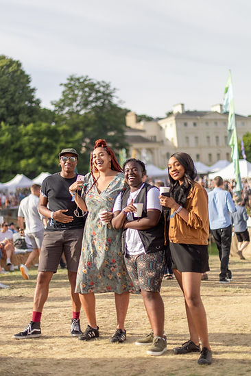 Group of teenagers smiling at Soho House Festival at Kenwood House