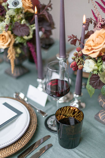 Blue linen napkins rattan placemats and pink candlesticks for autumnal winter tablescape styled shoot inspiration