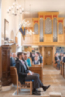 Groom waiting for bride in English church