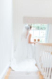 Bride walking down stairs in Jesus Peiro wedding dress from Miss Bush Bridal