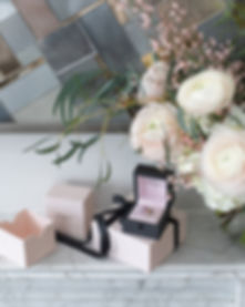 Boodles white marble fireplace with flowers colourful ring and pink packaging
