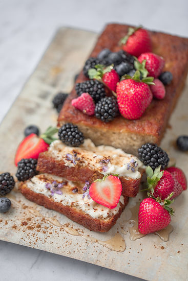 Fresh homemade banana bread with honey and fresh berries