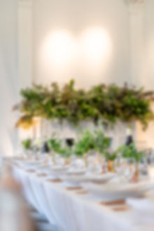 Long tablescape with foliage and fireplace for The Wing London event at ICA Gallery