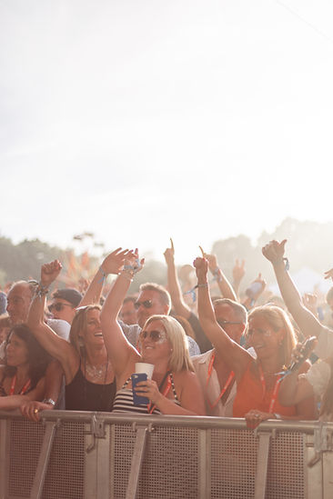 Front of festival crowds dancing with golden hour sunlight at Soho House Festival