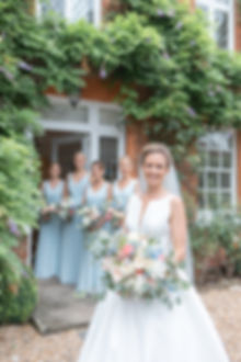 Bride holding bouquet in Jesus Peiro wedding dress from Miss Bush Bridal