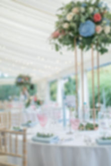 Floral green and white English wedding table centrepiece