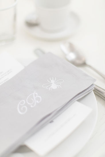 Bamford Brompton Cross neutral green foliage and white flowers tablescape with grey monogrammed embroidered napkin