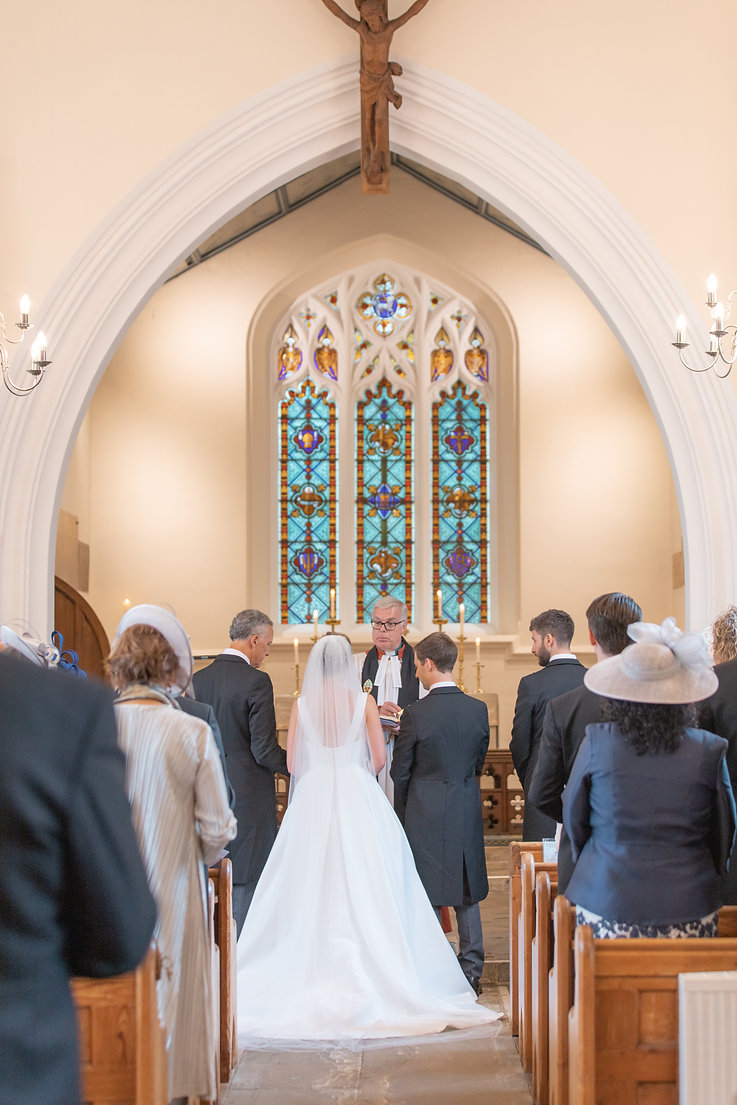 Bride and groom in church during English wedding cermony