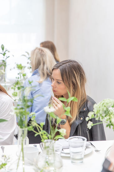 Guests smelling perfume at Bamford Brompton Cross breakfast event