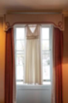 Marchesa bride dress in window luxury London wedding photography