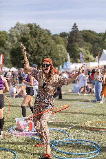 Women smiling hula hooping at Soho House Festival