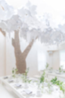 Bamford Brompton Cross neutral green foliage and white flowers tablescape with paper installation