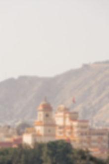 Red and orange clocktower in Jaipur India