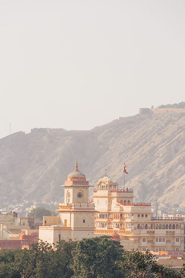 Red and orange clocktower in Jaipur India