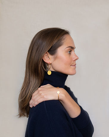 Model wearing LuluB jewellery earrings and bracelet