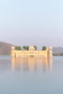 Yellow Jal Mahal Palace hotel on lake in Jaipur India