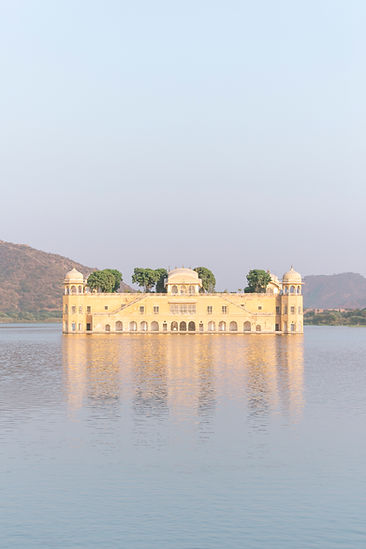 Yellow Jal Mahal Palace hotel on lake in Jaipur India