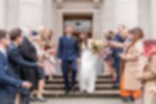 Bride and groom confetti steps Old Marylebone Town Hall luxury London wedding photographer