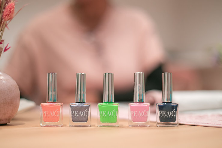 Colourful nail polish bottles at The Wing London launch party