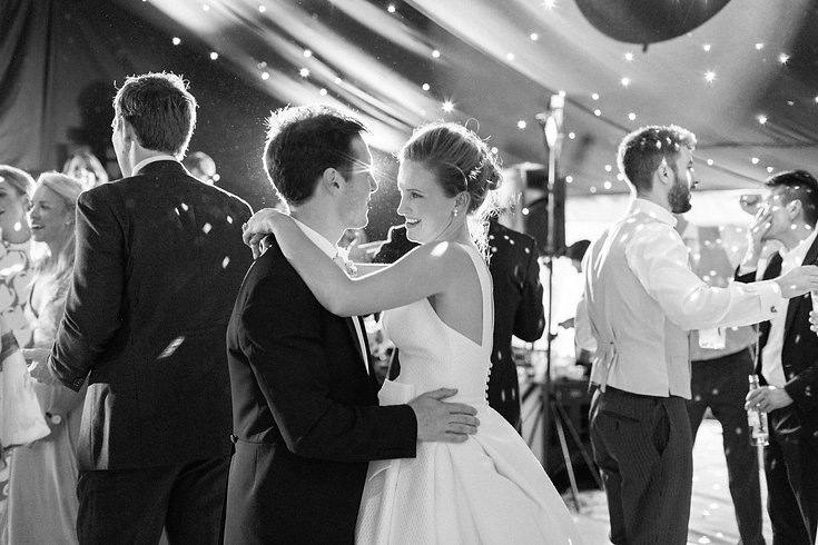 Bride and groom share romantic momenet on dancefloor