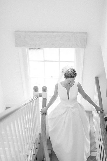 Bride with veil walking down stairs in Jesus Peiro wedding dress from Miss Bush Bridal