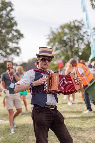 Man playing accordion at at Soho House Festival