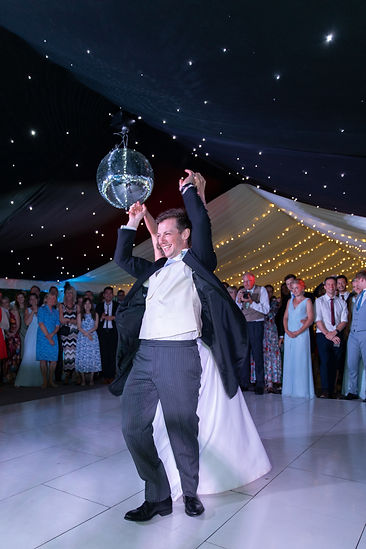 Bride and groom spinning during first dance