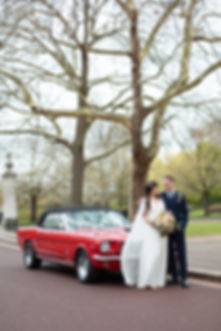 Bride and Groom with vintage red Ford mustang wedding car in Regents Park luxury London wedding photographer