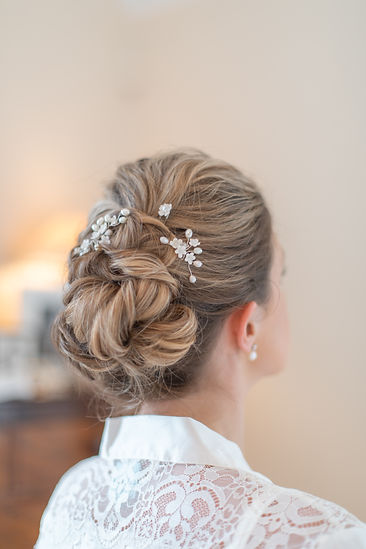 Bridal hairstyle inspiration low bun with pearl clip