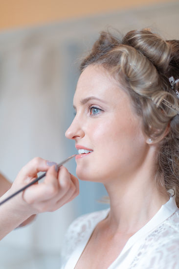Getting ready shots of bride having her make up done at English wedding