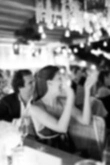 Black and white guest clapping during wedding speeches