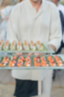 Smoked salmon and sushi canapes at beach wedding drinks reception