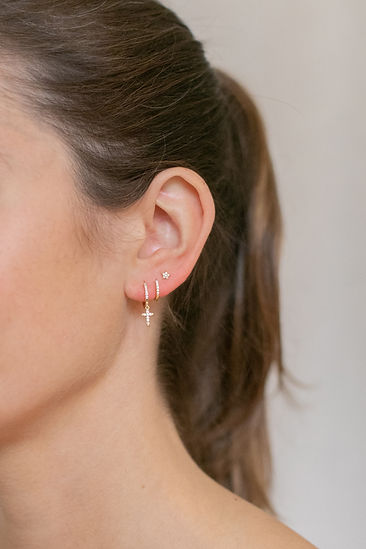 Model wearing LuluB jewellery cross earrings