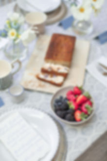 Breakfast brunch tablescape styled lifestyle shoot with banana bread and fresh berries