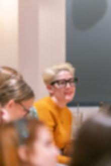 Female audience member smiling
