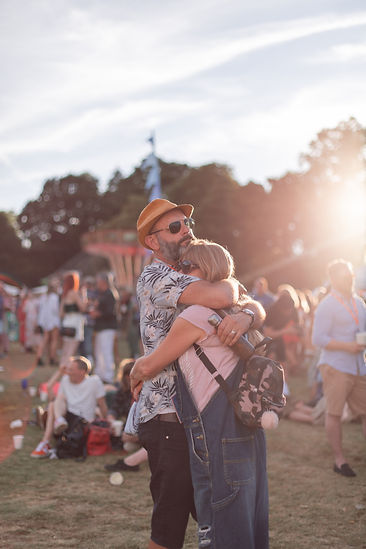 Man and women hugging during golden hour Golden hour fashion portrait at Soho House Festival