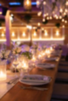 Solymar Mykonos Greek wedding dinner tablescape placesetting candles and hanging lanterns