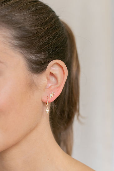 Model wearing LuluB jewellery lightning bolt earrings