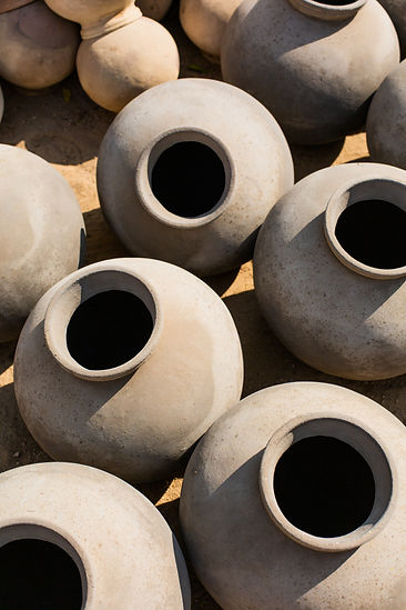 Traditional handmade ceramic pots with shadows in Jodhpur India