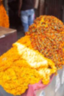 Colourful orange and yellow flower market in Varanasi India