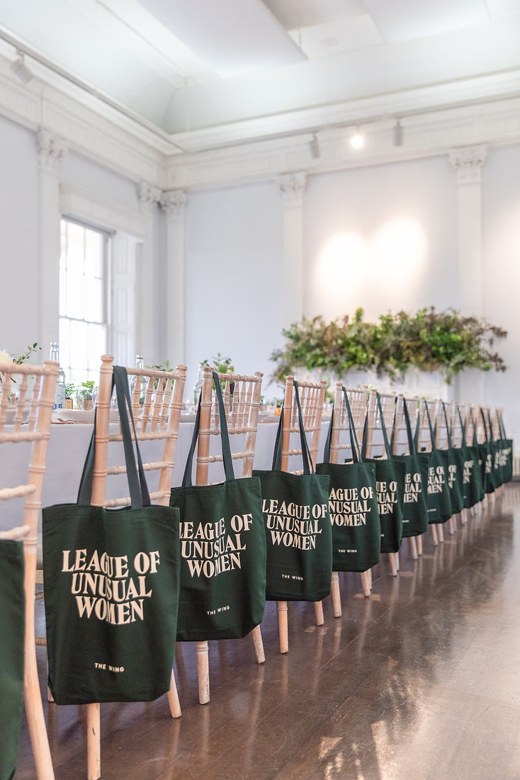 Long tables with tote bags at The Wing London event at ICA Gallery