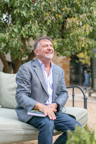 OBE celebrity chef Raymond Blanc smiling laughing at Soho Farmhouse Food Summit