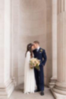 Bride and groom outside Old Marylebone Town Hall luxury London wedding photographer