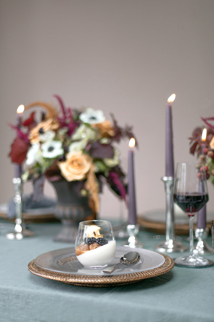 Compote yogurt dessert with rattan placemats and pink candlesticks for autumnal winter tablescape styled shoot inspiration