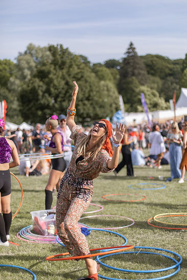 Women laughing hula hooping at Soho House Festival