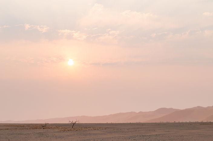Early morning sunrise over salt pans in Sossusvlei in the Namib desert South Africa