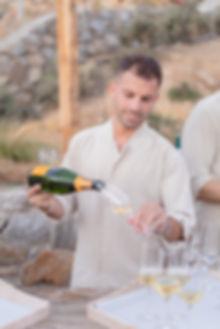 Champagne being poured at Mykonos Greek beach wedding drinks reception