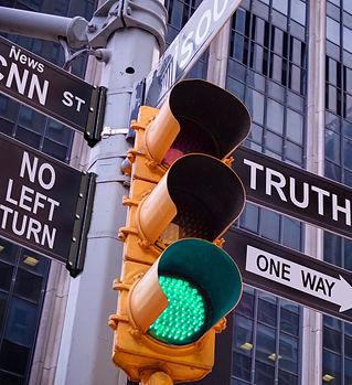 NYC Wall street yellow traffic green lig