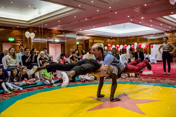Acrobatic circus performance in hotel in London